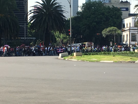 Demonstration down paseo de la Reforma on Interntional Worker's Rights Day