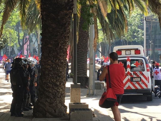 Demonstration down paseo de la Reforma on Interntional Worker's Rights Day. Police armed and ready to go if need-be.