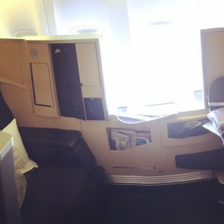 First class seat (turns into lie flat bed)